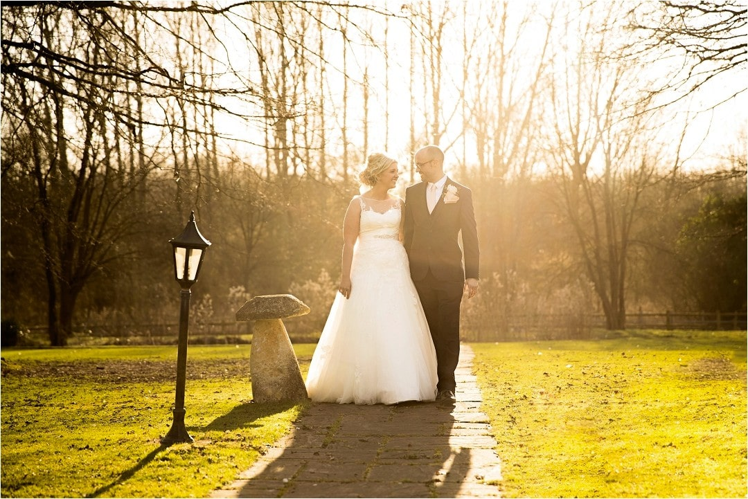 Beautiful couple walks down the garden at Mulberry House Essex during their CG Wedding Photography session in Hertfordshire