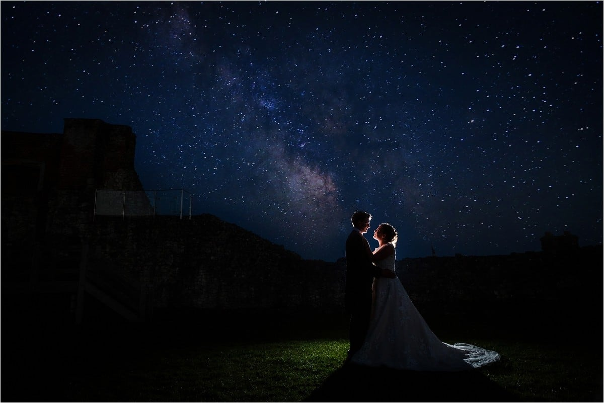 Night time wedding photograph of bride and groom taken at Farnham Castle, Hertfordshire